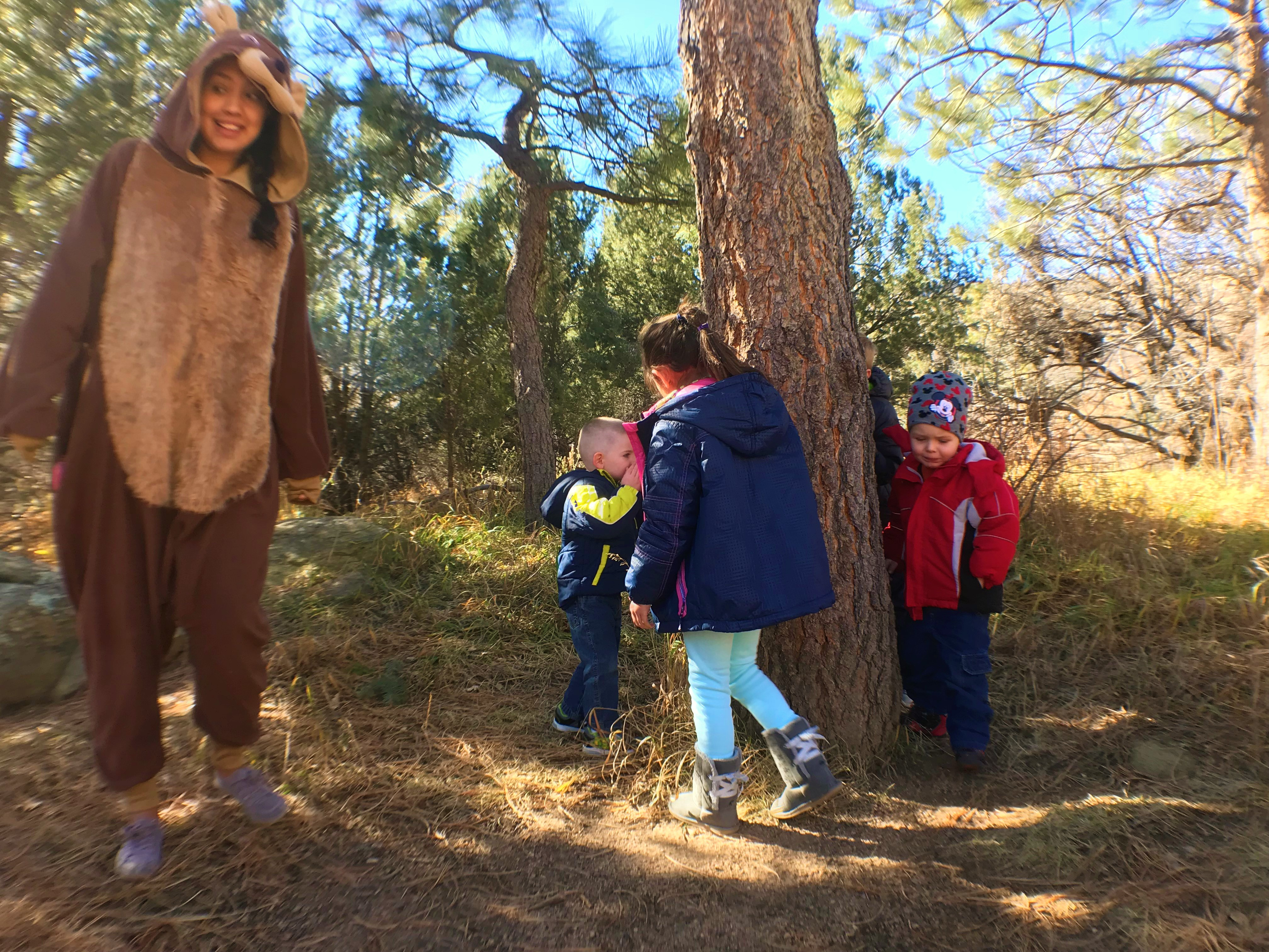 Children take a sniff of the candy tree during an All About Bears birthday party