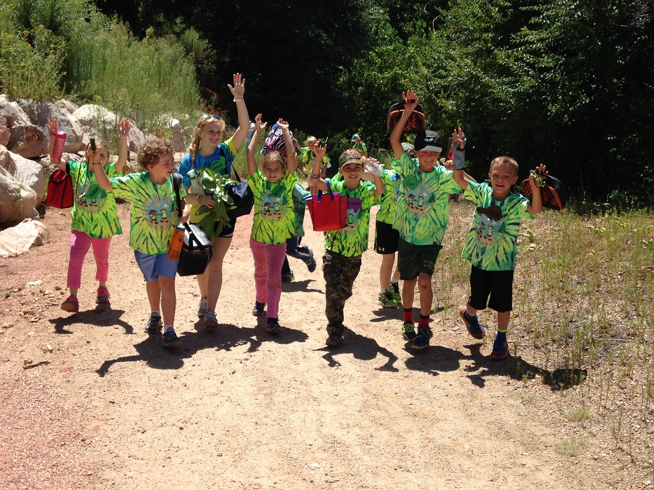 Nature campers walking down a trail