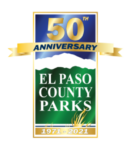 "50th Anniversary of El Paso County Parks Logo. 50th in gold shimmer lettering at the top, banner with Anniversary, image of pikes peak with green field and text ""EL PASO COUNTY PARKS"" and a gold banner at the bottom with the years ""197-2021"""